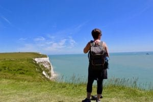 Woman Standing By Dover Cliffs